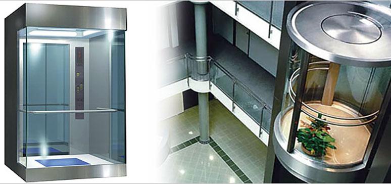 Thang máy vách kính bán nguyệt xen kẽ inox